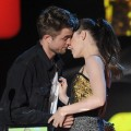 Robert Pattinson and Kristen Stewart lock lips on stage at the 2010 MTV Movie Awards in Los Angeles