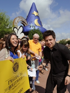 "Newly crowned ""American Idol"" Lee DeWyze takes a celebratory ride May 31, 2010 with Mickey Mouse through Disney's Hollywood Studios theme park in Lake Buena Vista, Fla. In addition to the parade at Disney's Hollywood Studios, DeWyze made a surprise appearance on-stage at ""The American Idol Experience,"" the theme park's attraction based on the hit TV show."