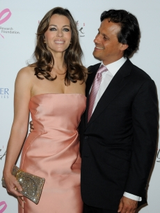 Elizabeth Hurley and husband Arun Nayar attend the Evelyne H. Lauder photo Exhibition at Galeries Lafayette, Paris, France, June 1, 2010