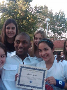 LA Lakers star Ron Artest with some of the students at Billy's daughter's school
