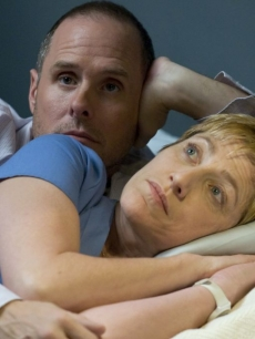 Edie Falco as Nurse Jackie Peyton and Paul Schulze as pharmacist Eddie get close on Showtime's 'Nurse Jackie,' Season 1
