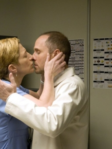 Edie Falco as Nurse Jackie Peyton and Paul Schulze as pharmacist Eddie share a kiss on Showtime's 'Nurse Jackie,' Season 1