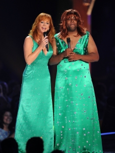 Reba McEntire and Kenan Thompson perform onstage at the CMT Music Awards at the Bridgestone Arena in Nashville on June 9, 2010