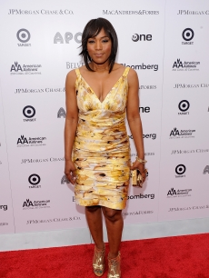Angela Bassett poses for photographers on the red carpet at the Spring Benefit Concert and Awards Ceremony at The Apollo Theater in New York City on June 14, 2010