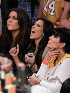 Khloe and Kim Kardashian cheer on the LA Lakers alongside their mom, Kris Jenner, at Game 7 of the NBA Finals between the Boston Celtics and LA Lakers at the Staples Center in Los Angeles on June 17, 2010