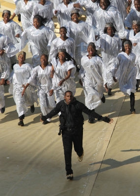 R Kelly performs with the Soweto Spiritual singers at the Opening Ceremony of the FIFA World Cup at Soccer City Stadium in Johannesburg, South Africa on June 11, 2010