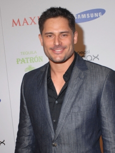 Joe Manganiello smiles for the camera at The Maxim Party hosted by Samsung, Patron, Gillette & Pepsi Max at The Ritz Ybor in Tampa, Florida on January 30, 2009