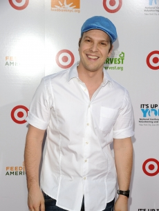 Gavin DeGraw smiles for the camera on the red carpet at the 'Party for Good - Making Meals to Feed Young Minds' event at Basketball City - Pier 36 - South Street in New York City on June 29, 2010
