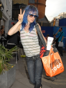 A blue-haired Juliette Lewis shows off a peace sign as she heads into The Borderline concert venue, London, June 30, 2010A blue-haired Juliette Lewis shows off a peace sign as she heads into The Borderline concert venue, London, June 30, 2010