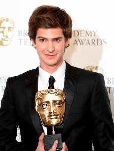 Andrew Garfield poses in front of the winners boards with the Best Actor Award at the British Academy Television Awards 2008 supported by Sky+ at the Palladium, London, April 20, 2008