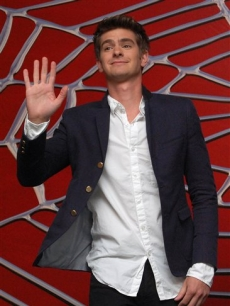 Andrew Garfield waves and flashes a smile at photographers as he is announced as the new &#8220;Spider-Man&#8221; during a media event in Cancun, Mexico, 1 July 2010