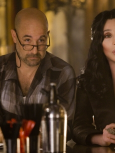 "Cher and Stanley Tucci have a drink together in the new film ""Burlesque"""