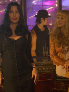 "Cher and Christina Aguilera chat at a bar in their new film ""Burlesque"""