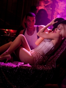  Christina Aguilera seduces her audience as her character, Ali, in fishnet stockings and a tight, jeweled corset in the new film &#8220;Burlesque&#8221;
