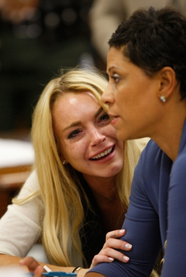 Lindsay Lohan breaks down in tears as she is sentenced to 90 days in jail at her probation revocation hearing at the Beverly Hills Courthouse in Los Angeles, Calif., on July 6, 2010