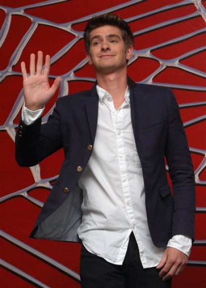 "Andrew Garfield waves and flashes a smile at photographers as he is announced as the new ""Spider-Man"" during a media event in Cancun, Mexico, 1 July 2010"