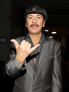 Carlos Santana poses backstage at the 41st NAACP Image awards held at The Shrine Auditorium in Los Angeles, California on February 26, 2010