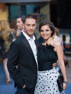 "Tom Hardy and fiancee Charlotte Riley pose for the cameras at the London premiere for ""Inception"" at the Odeon Leicester Square in London, England on July 8, 2010"