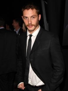 Tom Hardy arrives in a black suit and tie at the Kuro Black Screen party at Claridge's hotel in London, England on September 25, 2007