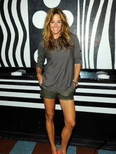 """Real Housewives of New York"" star Kelly Bensimon poses for pictures at the collection launch of Alice and Olivia by Stacey Bendet M.A.C. Cosmetics at Beauty Bar in New York City on July 14, 2010"