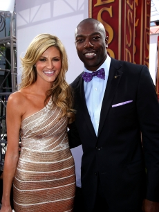 NFL star Terrell Owens poses with Erin Andrews on the red carpet for the ESPY Awards at Nokia Theatre L.A. Live in Los Angeles on July 14, 2010