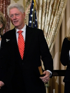 Chelsea Clinton, Bill Clinton, and Hillary Clinton attend Hillary's swearing in as U.S. Secretary of State on February 2, 2009