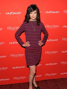 "Katie Holmes poses on the red carpet at the ""The Extra Man"" premiere at the Village East Cinema in New York City on July 19, 2010"