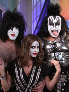 Access&#8217; Maria Menounos poses next to Gene Simmons and Paul Stanley as an honorary member of KISS in Burbank, Calif., on July 19, 2010