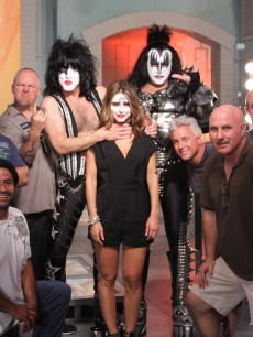 KISS rock stars Gene Simmons and Paul Stanley pose with the Access Hollywood team on the set of Access Hollywood in Burbank, Calif., on July 19, 2010