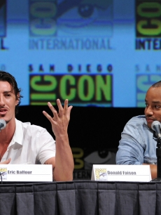 "Eric Balfour and Donald Faison speak onstage at the ""Skyline"" panel discussion during Comic-Con International at the San Diego Convention Center in San Diego, Calif., on July 23, 2010"