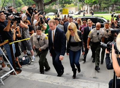 Photographers surround Lindsay Lohan as she arrived at the Beverly Hills Courthouse where she surrendered to serve her 90-day jail sentence, on July 20, 2010