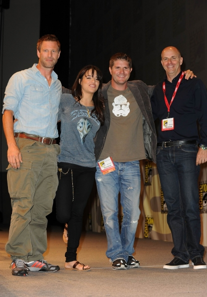 "Aaron Eckhart, Michelle Rodriguez, director Jonathan Liebesman and producer Neal Moritz pose together on stage at the ""Battle: Los Angeles"" panel at Comic-Con International at the San Diego Convention Center in San Diego, Calif., on July 22, 2010"