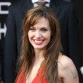 Angelina Jolie charms her fans with a warm smile on the red carpet at the premiere of &#8220;Salt&#8221; in Oktyabr cinema hall in Moscow, Russia, on July 25, 2010