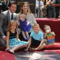 Doting dad Mark Wahlberg poses with his family — wife Rhea Durham, Ella, Grace, Michael and Brendan — as he receives his Walk of Fame star, LA, July 29, 2010