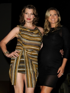 "Milla Jovovich and Ali Larter pose together onstage at the ""Resident Evil: Afterlife"" panel discussion during Comic-Con at San Diego Convention Center in San Diego, Calif., on July 24, 2010"