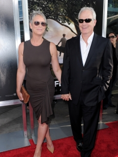 "Jamie Lee Curtis arrives with husband Christopher Guest at the ""Flipped"" premiere in Hollywood, Calif., on July 26, 2010"