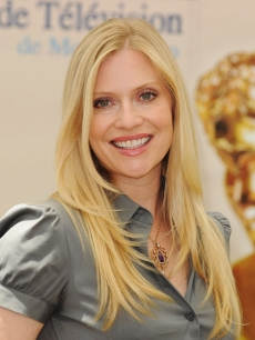 "Emily Procter poses at a photocall for ""CSI: Miami"" during the 2009 Monte Carlo Television Festival held at Grimaldi Forum, Monte Carlo, June 11, 2009"