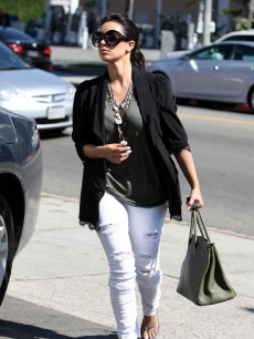 Kim Kardashian steps out in ripped jeans in Beverly Hills, July 29, 2010