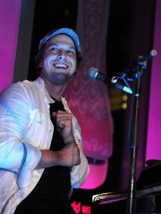 Musician Gavin DeGraw sings on stage at the Schick Intuition Kiss & Tell summer party at Stone Rose at the Time Warner Center in New York City on August 5, 2010