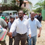 Wyclef Jean greets his neighbors before heading off for a meeting with Haitian President Rene Preval in Port-au-Prince, Haiti, on August 19, 2010