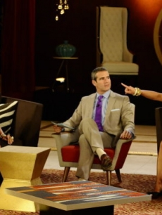 "Teresa Giudice screams at Danielle Staub as Andy Cohen looks on during ""The Real Housewives of New Jersey"" reunion special, Aug. 2010"