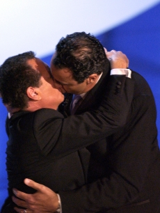 Garry Shandling kisses Emmy Nominee Brad Garrett at the 55th Annual Primetime Emmy Awards in 2003