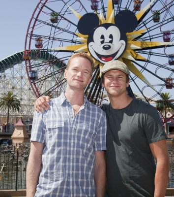 Soon-to-be parents Neil Patrick Harris and David Burtka pose at Paradise Pier at Disney's California Adventure in Anaheim, Calif., Aug. 14, 2010