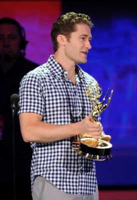 """Glee"" star Matthew Morrison gets ahold of an Emmy onstage during rehearsals for the 62nd annual Primetime Emmy Awards on August 28, 2010 in Los Angeles, Calif."