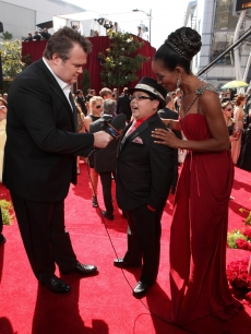 """Modern Family's"" Eric Stonestreet interviews Rico Rodriguez on the Emmys red carpet as Access Hollywood's Shaun Robinson looks on, LA, Aug. 29, 2010"