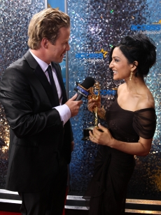 "Access' Billy Bush interviews ""The Good Wife"" star and Emmy winner Archie Panjabi backstage at the event, LA, Aug. 29, 2010"