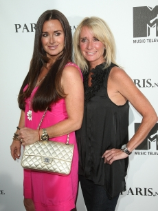 "Kyle Richards and Kim Richards arrive at a screening of ""Paris, Not France"" documentary at The Majestic Crest in Los Angeles on July 22, 2009"