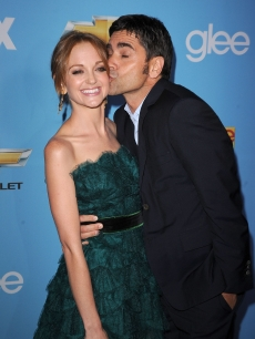 "Jayma Mays and John Stamos share a kiss at the ""Glee"" Season 2 premiere held at Paramount Studios in Hollywood on September 7, 2010"