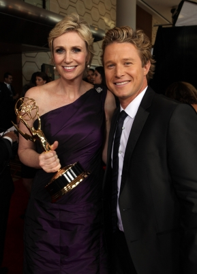 """Glee's"" Jane Lynch and Access' Billy Bush backstage at the Emmys, LA, Aug. 29, 2010"