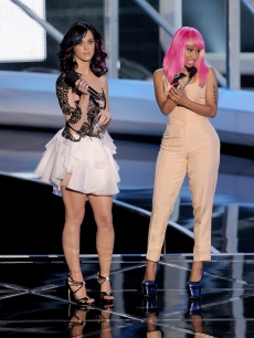 Katy Perry and Nicki Minaj speak onstage during the 2010 MTV Video Music Awards at NOKIA Theatre L.A. LIVE in Los Angeles on September 12, 2010